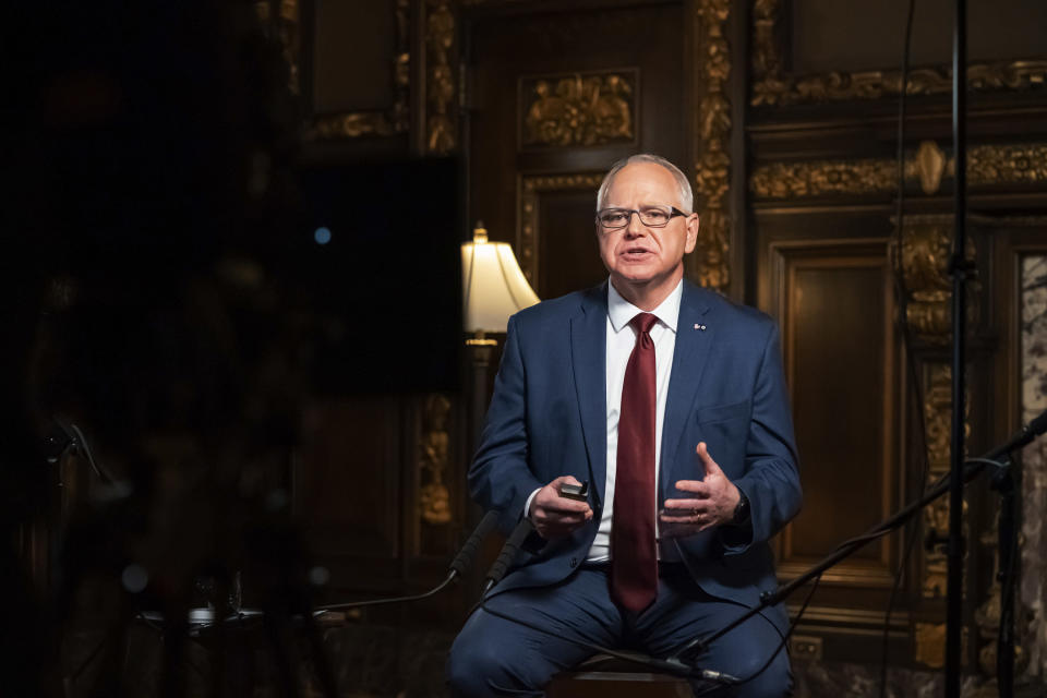 Minnesota Gov. Tim Walz speaks from the Governor's Reception room at the State Capitol, to discuss the latest steps in his response to COVID-19, Wednesday, Nov. 18, 2020, in St. Paul, Minn. (Glen Stubbe/Star Tribune via AP, Pool)