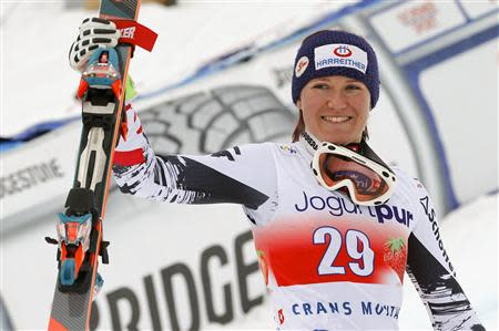 Fischbacher of Austria celebrates winning the women's FIS Alpine Skiing World Cup Downhill race on her way to the podium in the Swiss resort of Crans Montana