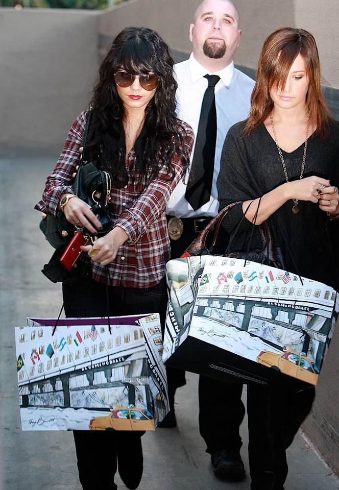 "A bodyguard escorts bag-toting BFFs Vanessa Hudgens and Ashley Tisdale back to their chauffeured car. NT/<a href=""http://www.x17online.com"" target=""new"">X17 Online</a> - November 28, 2008"