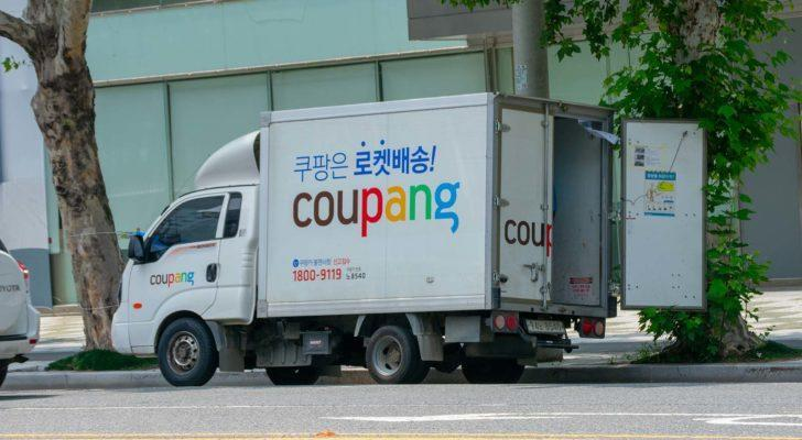 A close-up shot of a Coupang (CPNG) delivery vehicle.