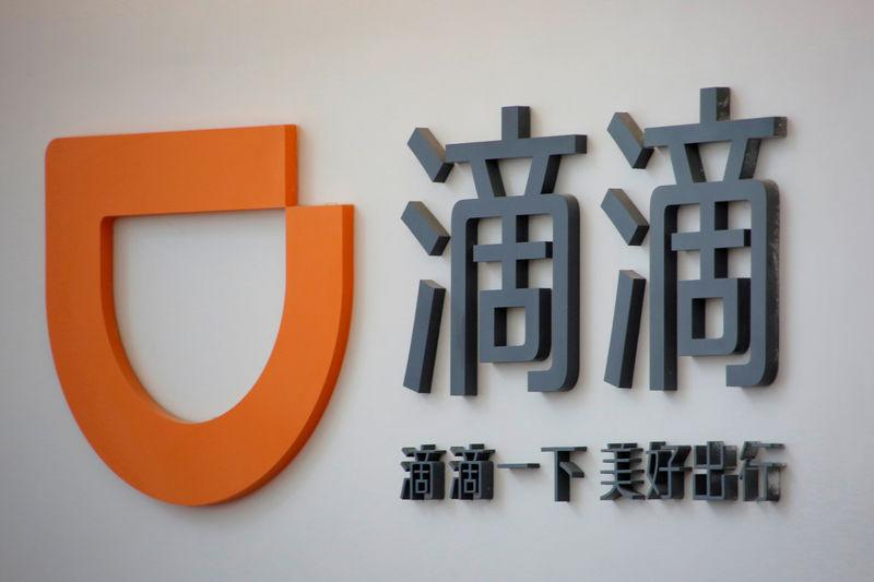 FILE PHOTO: Logo of Didi Chuxing is seen at its headquarters in Beijing