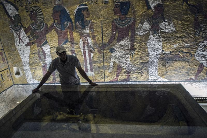 An Egyptian archaeologist looks at the sarcophagus of King Tutankhamun in his burial chamber in the Valley of the Kings, close to Luxor, on September 28, 2015 (AFP Photo/Khaled Desouki)