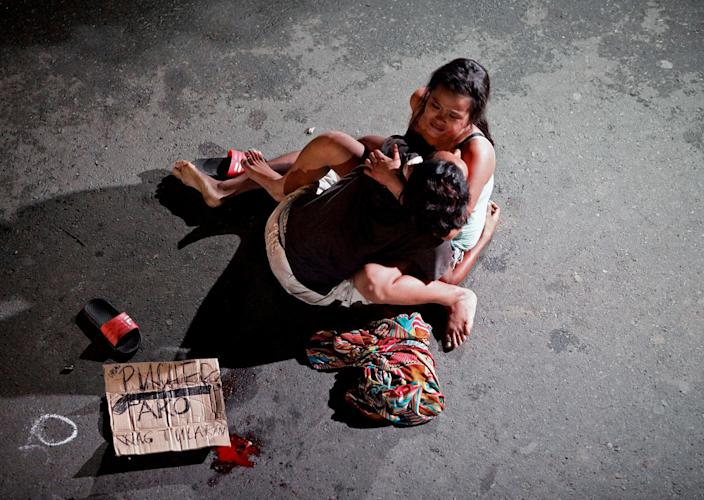 <p>JUL. 23, 2016 — Jennilyn Olayres, 26, weeps over the body of her partner, who was killed on a street in Pasay city, Metro Manila, Philippines July 23, 2016. Czar Dancel: 'When the image of Olayres weeping as she cradled the body of her slain partner went viral in the Philippines, President Rodrigo Duterte called it melodramatic. He mentioned the image of Olayres in his state of the union address and said media had tried to portray it as being like the Michelangelo's Pieta, the sculpture of Mary holding the body of Jesus. (Czar Dancel/Reuters) </p>