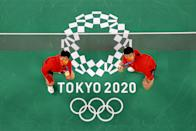 <p>CHOFU, JAPAN - JULY 31: Gold medalists of Mix Doubles badminton event Wang Yi Lyu(right) and Huang Dong Ping of Team China pose for photo on day eight of the Tokyo 2020 Olympic Games at Musashino Forest Sport Plaza on July 31, 2021 in Chofu, Tokyo, Japan. (Photo by Rob Carr/Getty Images)</p>