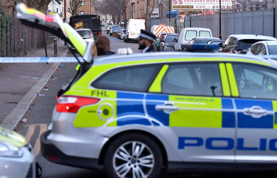 The scene where an unidentified 14-year-old boy died late Tuesday after he was found with stab injuries, in the Waltham Forest area of north-east London, England, Wednesday Jan. 9, 2019.   The recent rise in knife crime has prompted London Mayor Sadiq Khan to call to for a task force to address violent crime. (John Stillwell/PA via AP)