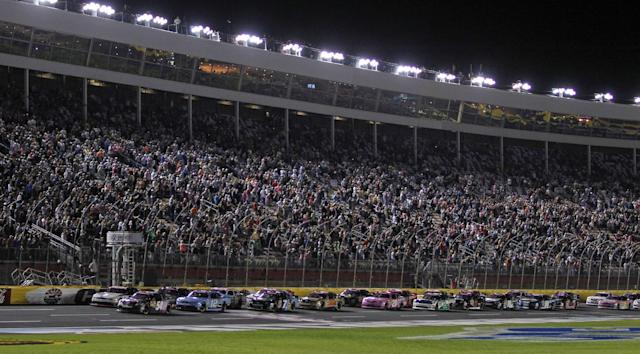 Kyle Busch (54) leads the field at the start of a NASCAR Nationwide series auto race at Charlotte Motor Speedway in Concord, N.C., Friday, Oct. 11, 2013. (AP Photo/Terry Renna)
