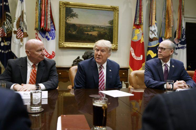 President Trump, flanked by Rep. Kevin Brady, R-Texas, left, and Rep. Greg Walden, R-Ore., at a White House meeting on health care March 10. (Photo: Evan Vucci/AP)