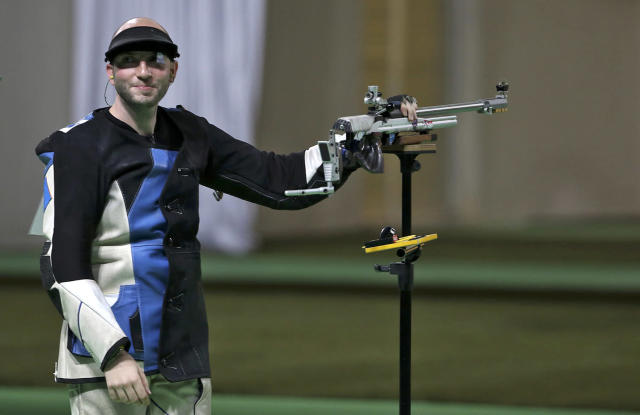 <p>Niccolo Campriani of Italy reacts to winning the men's 50m rifle 3 positions final at the Olympic Shooting Center in Rio on August 14, 2016. (REUTERS/Edgard Garrido) </p>