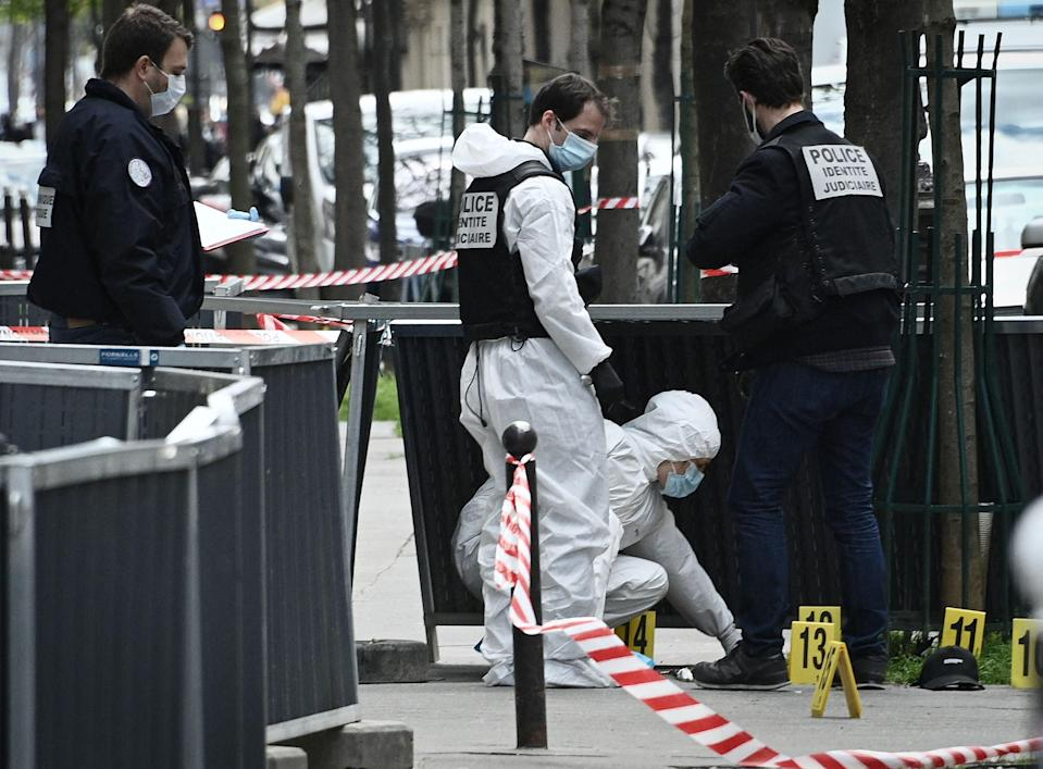 French police forensic investigators search for evidence near the Henry Dunant private hospitalAFP via Getty Images