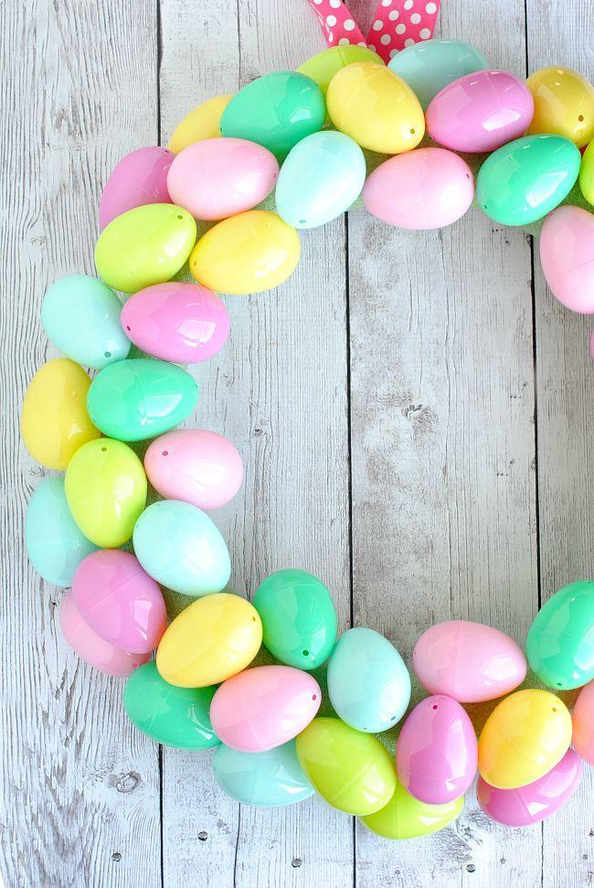 """<p>'Tis the season for pastels! Gather up pastel plastic Easter eggs and use them to craft this springtime creation. </p><p><strong>Get the tutorial at <a href=""""https://crazylittleprojects.com/easter-egg-wreath/"""" rel=""""nofollow noopener"""" target=""""_blank"""" data-ylk=""""slk:Crazy Little Projects"""" class=""""link rapid-noclick-resp"""">Crazy Little Projects</a>.</strong></p><p><a class=""""link rapid-noclick-resp"""" href=""""https://go.redirectingat.com?id=74968X1596630&url=https%3A%2F%2Fwww.walmart.com%2Fip%2FWay-to-Celebrate-Easter-40-MM-Pastel-Plastic-Easter-Eggs-250-Count%2F533913135&sref=https%3A%2F%2Fwww.thepioneerwoman.com%2Fhome-lifestyle%2Fcrafts-diy%2Fg35698457%2Fdiy-easter-wreath-ideas%2F"""" rel=""""nofollow noopener"""" target=""""_blank"""" data-ylk=""""slk:SHOP PASTEL EGGS"""">SHOP PASTEL EGGS</a></p>"""