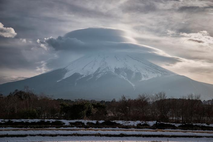 The photograph was taken in Fujiyoshida, Yamanashi prefecture. Fujiyoshida is considered as one of the best places to admire the beauty of Mount Fuji and the gateway for climbing Mt. Fuji via the Yoshida trail, the most popular trail to the summit.