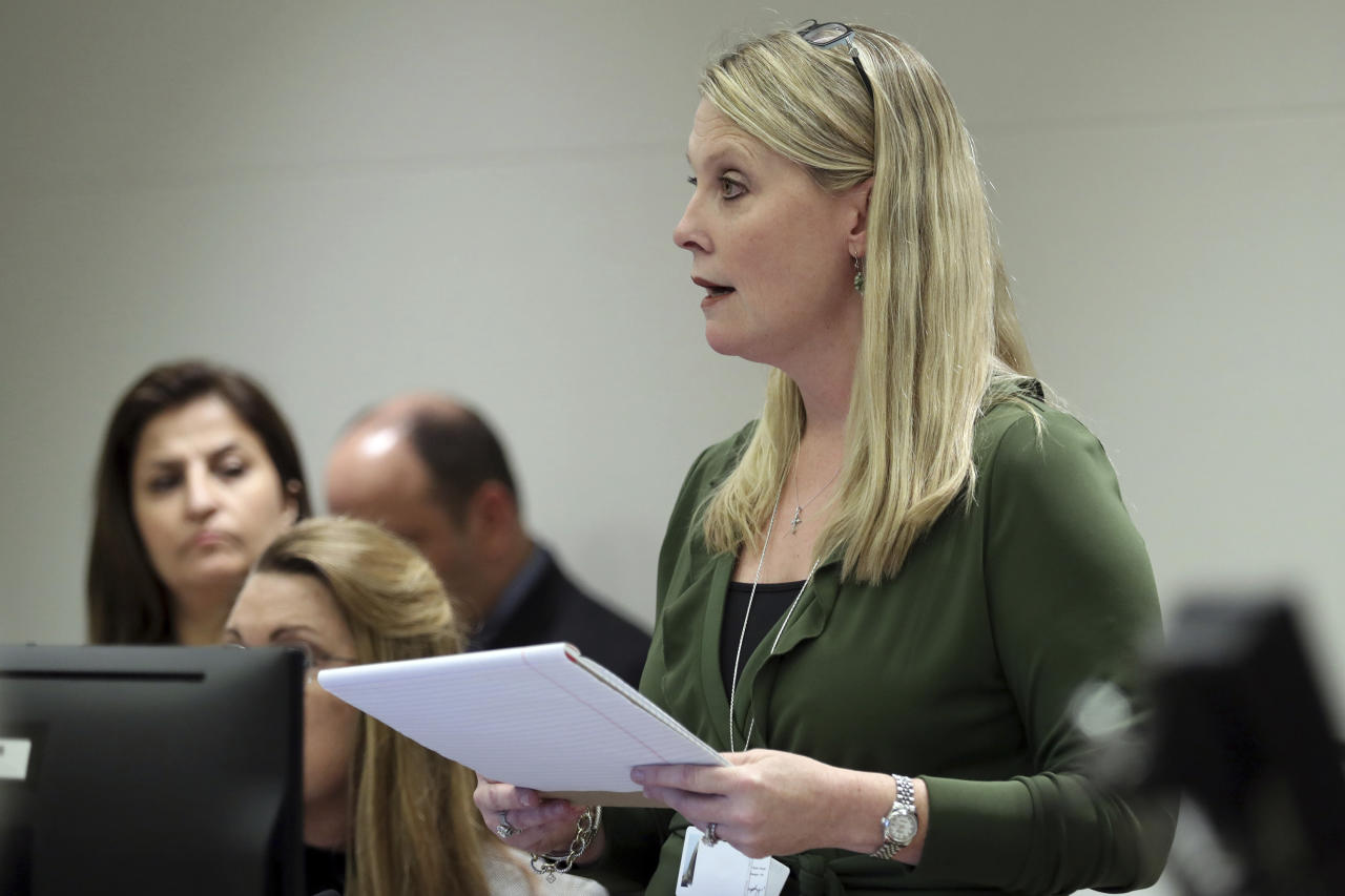 Assistant State Attorney Sarahnell Murphy argues for a very high bond for Zachary Cruz, the brother of the Florida school shooting suspect, during Cruz's first appearance on charges of trespassing on the grounds of Marjory Stoneman Douglas High School, Tuesday, March 20, 2018, at the Broward County Courthouse in Fort Lauderdale, Fla. A judge set an unusually high $500,000 bond on Tuesday and imposed a host of other restrictions. (Amy Beth Bennett/South Florida Sun-Sentinel via AP, Pool)