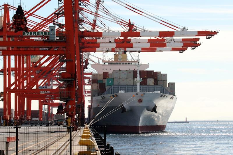 Overseas shipments by value declined 2.1%, the first fall since August of last year, while the value of exports by Japanese companies to China shrank 3.6% in October as growth in the Japanese economy slows (AFP Photo/Yoshikazu Tsuno)