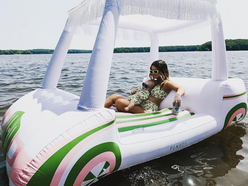 """<p>Maren Morris and her son Hayes chilled out in matching green suits while <a href=""""https://people.com/parents/maren-morris-husband-ryan-hurd-claps-back-mommy-shamers/"""" rel=""""nofollow noopener"""" target=""""_blank"""" data-ylk=""""slk:lounging on a pool float in a shallow lake"""" class=""""link rapid-noclick-resp"""">lounging on a pool float in a shallow lake</a>. </p>"""
