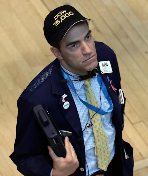 """Trader Gregory Rowe wears a """"Dow 15,000"""" hat as he works on the floor of the New York Stock Exchange Friday, May 3, 2013. A big gain in the job market is lifting the stock market to a record high. The Dow Jones industrial average crossed 15,000 for the first time, and the Standard and Poor's 500 index, a broader market measure, rose above 1,600.(AP Photo/Richard Drew)"""