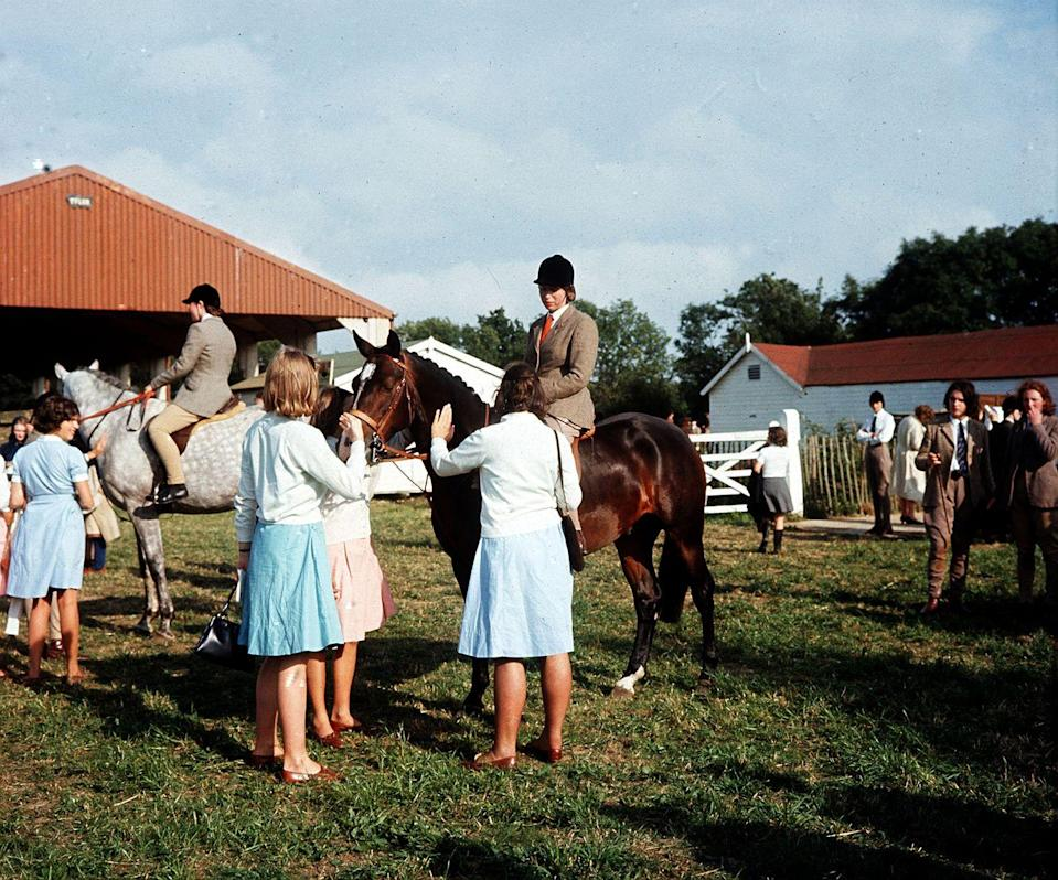 <p>Riding in her first show jumping competition for her boarding school, Benenden College, in July 1964. </p>