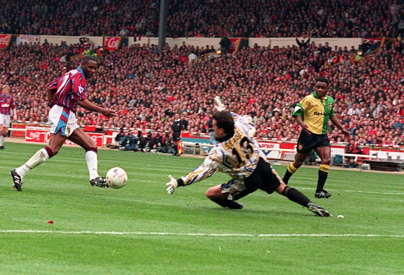 Manchester United goalkeeper Les Sealey dives in vain as Dalian Atkinson scores the 1st goal for Aston Villa in the Coca Cola Cup Final at Wembley. (Photo by Tony Harris - PA Images/PA Images via Getty Images)