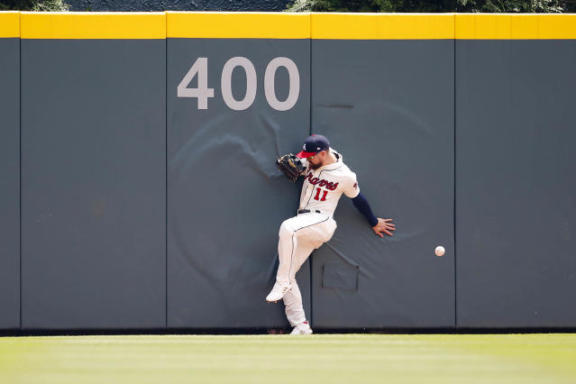 Atlanta Braves center fielder Ender Inciarte (11) leaps for the ball and is injured attempting to catch a ball in the fourth inning of a baseball game, Sunday, May 20, 2018, in Atlanta. (AP Photo/Todd Kirkland)