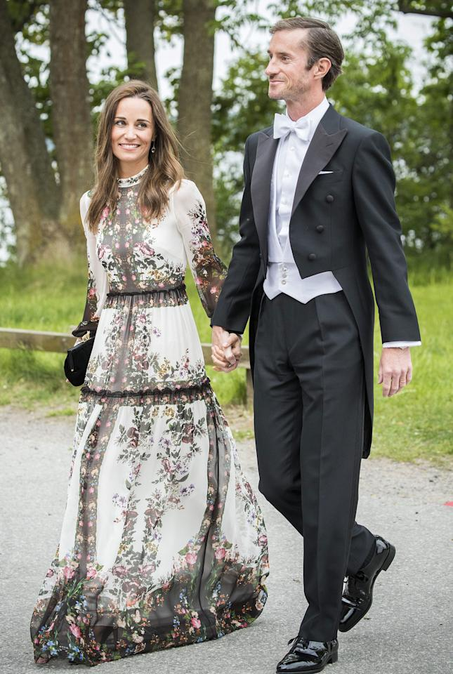 <p>These newlyweds made sure they were their best-dressed selves attending a friend's wedding in Stockholm a few weeks after their own nuptials. Pippa wore a white dress by Erdem with a pretty floral print - super pretty, but is white ever appropriate to a wedding? We're split on this one!</p>