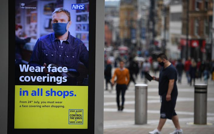 Police are not expected to be called in to enforce the compulsory wearing of face masks in shops in England from Friday, a minister has said. - OLI SCARFF/AFP