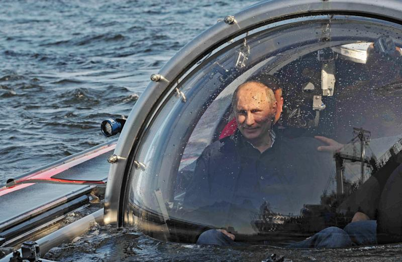 Russian President Vladimir Putin submerges on board Sea Explorer 5 bathyscaphe off the island of Gogland 180 kilometers (110 miles) west of St. Petersburg, Russia, Monday, July 15, 2013. Putin rode the small submersible craft 60 meters (200 feet) down to see the remains of the naval frigate Oleg, which sank in 1869, Russian news reports said. Putin's latest media event was modest by the stunt-happy Russian leader's standards, a half-hour trip to the bottom of the Gulf of Finland to see a shipwreck. (AP Photo/RIA-Novosti, Alexei Nikolsky, Presidential Press Service)