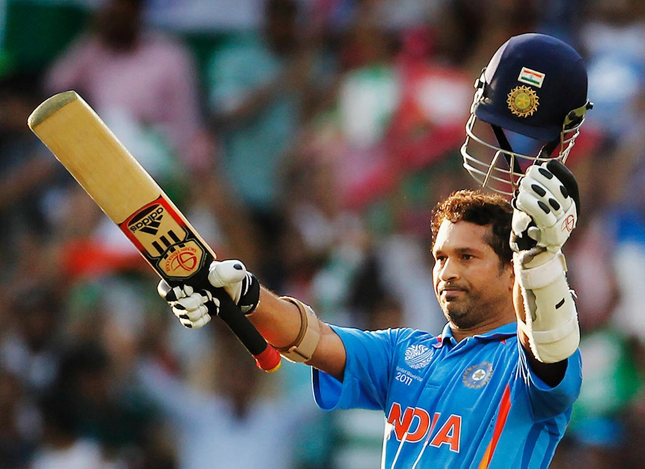 NAGPUR, INDIA - MARCH 12:  Sachin Tendulkar of India raises his bat on scoring his century during the Group B ICC World Cup Cricket match between India and South Africa at Vidarbha Cricket Association Ground on March 12, 2011 in Nagpur, India.  (Photo by Daniel Berehulak/Getty Images)