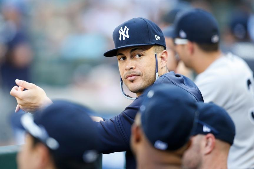 Aug 28, 2019; Seattle, WA, USA; New York Yankees outfielder Giancarlo Stanton (27) sits in the dugout during the ninth inning against the Seattle Mariners at T-Mobile Park. Mandatory Credit: Joe Nicholson-USA TODAY Sports