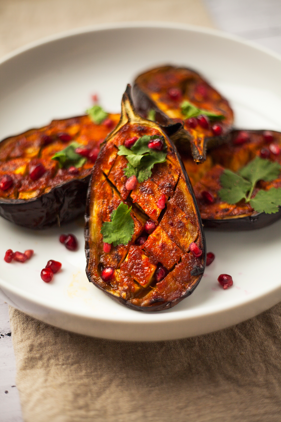 """<p>This vegan-friendly centrepiece is super simple but looks oh-so impressive served up on a platter.</p><p><strong>Recipe: <a href=""""https://www.goodhousekeeping.com/uk/food/recipes/a27482624/harissa-aubergine/"""" rel=""""nofollow noopener"""" target=""""_blank"""" data-ylk=""""slk:Harissa aubergine"""" class=""""link rapid-noclick-resp"""">Harissa aubergine</a></strong></p>"""