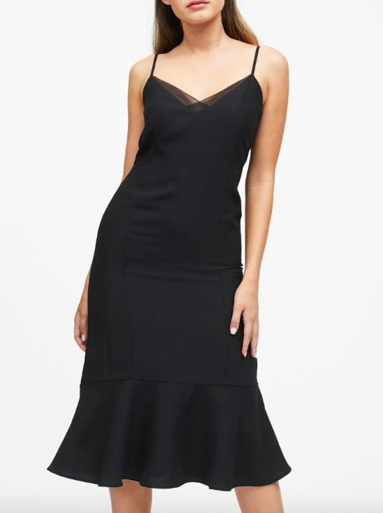 """<p>This <a href=""""https://www.popsugar.com/buy/Fishtail-Midi-Sheath-Dress-526048?p_name=Fishtail%20Midi%20Sheath%20Dress&retailer=bananarepublic.gap.com&pid=526048&price=149&evar1=fab%3Auk&evar9=46964732&evar98=https%3A%2F%2Fwww.popsugar.com%2Ffashion%2Fphoto-gallery%2F46964732%2Fimage%2F46964746%2FFishtail-Midi-Sheath-Dress&prop13=api&pdata=1"""" rel=""""nofollow"""" data-shoppable-link=""""1"""" target=""""_blank"""" class=""""ga-track"""" data-ga-category=""""Related"""" data-ga-label=""""http://bananarepublic.gap.com/browse/product.do?pid=517500002&amp;cid=1121080&amp;pcid=69883&amp;vid=1&amp;grid=pds_41_398_1#pdp-page-content"""" data-ga-action=""""In-Line Links"""">Fishtail Midi Sheath Dress</a> ($149) is a perfect modern black tie pick. Or wear a blazer on top when you won't have time for a full day-to-night outfit change. </p>"""