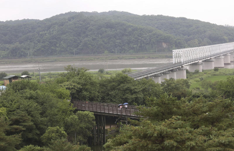 Visitors walk on the Freedom Bridge at the Imjingak Pavilion in Paju, near the border with North Korea, South Korea, Wednesday, July 31, 2019. South Korea's military said North Korea conducted its second weapons test in less than a week Wednesday, firing two short-range ballistic missiles off its east coast in a move observers say could be aimed at boosting pressure on the United States as the rivals struggle to set up fresh nuclear talks.(AP Photo/Ahn Young-joon)