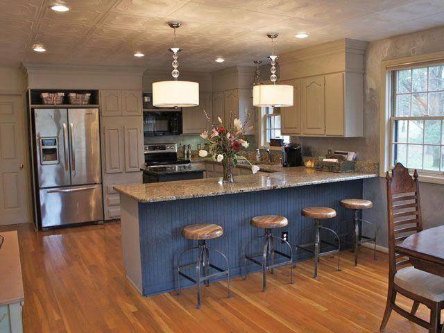 "<p>This blogger removed the popcorn ceiling and added ""tin"" Styrafoam tiles on top. Then, she painted all of her cabinets a brown, cream color to give the room a rustic touch.</p><p><a href=""http://bella-tucker.com/2012/02/our-new-house-kitchen-makeover-chalk-painted-cabinets/"" rel=""nofollow noopener"" target=""_blank"" data-ylk=""slk:See more at Bella Tucker »"" class=""link rapid-noclick-resp""><em>See more at Bella Tucker »</em></a></p>"