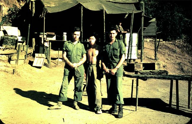 "<span style=""font-size:11.0pt;  "">A Korean local with two 1 PPCLI cooks. Circa 1952. Photo courtesy of <a href=""http://www.thememoryproject.com/stories/Korea/"" target=""_blank"">Ron Carruth</a> and <a href=""http://www.thememoryproject.com"" target=""_blank"">Historica-Dominion Institute</a>.</span>"