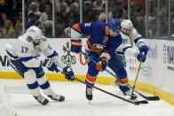 Tampa Bay Lightning left wing Alex Killorn (17) and center Steven Stamkos (91) fight for control over the puck against New York Islanders defenseman Nick Leddy (2) during the third period of Game 3 of the NHL hockey Stanley Cup semifinals, Thursday, June 17, 2021, in Uniondale, N.Y. (AP Photo/Frank Franklin II)