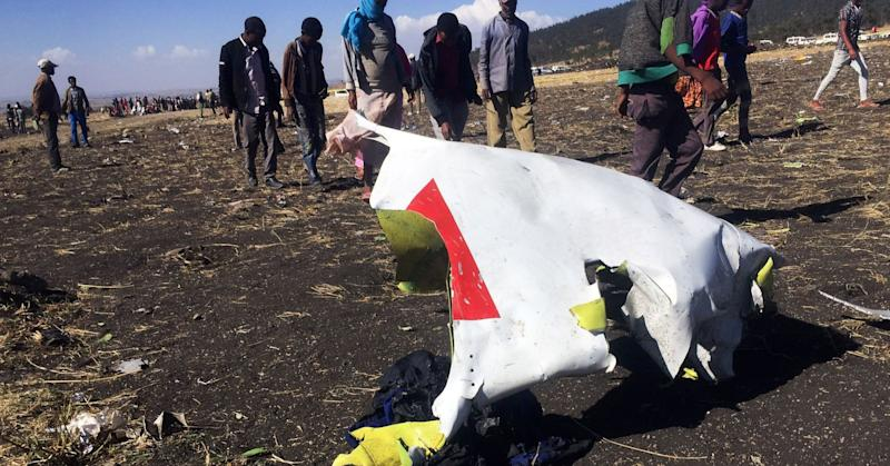 People walk past a part of the wreckage at the scene of the Ethiopian Airlines Flight ET 302 plane crash, near the town of Bishoftu, southeast of Addis Ababa, Ethiopia March 10, 2019.