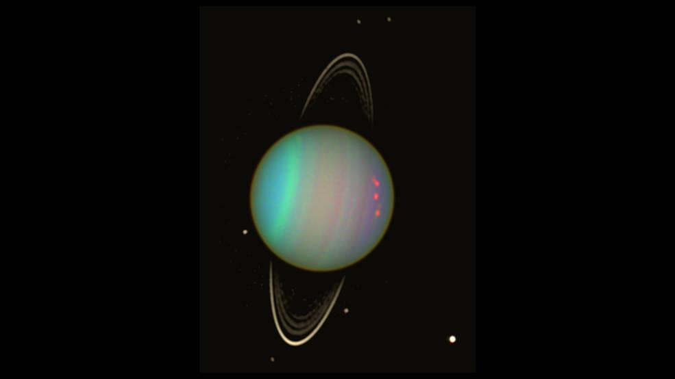 <p>The first images of the giant ice planet's auroras were taken by the Hubble Space Telescope in November 2011. Photo from NASA. </p>