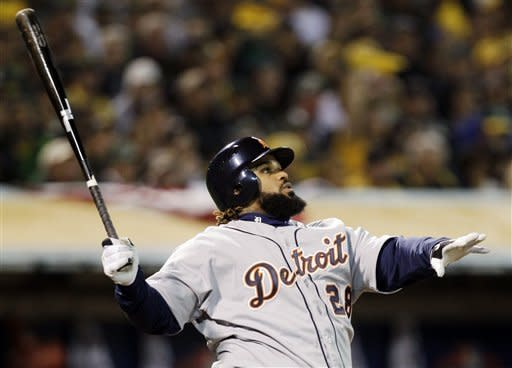 Detroit Tigers's Prince Fielder watches the flight of his solo home run in the fourth inning of Game 4 of their American League division baseball series against the Oakland Athletics in Oakland, Calif., Wednesday, Oct. 10, 2012. (AP Photo/Ben Margot)