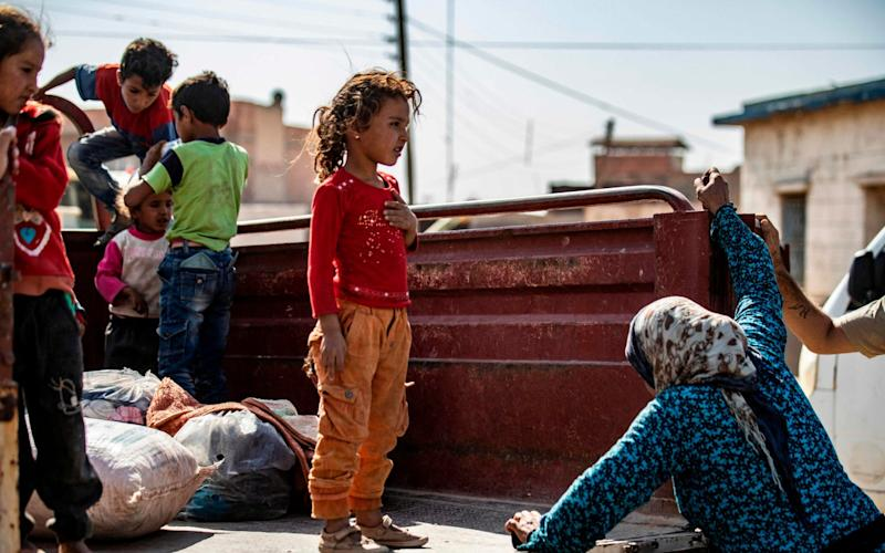 Aid agencies have warned of a looming humanitarian catastrophe as thousands flee their homes in northern Syria - AFP