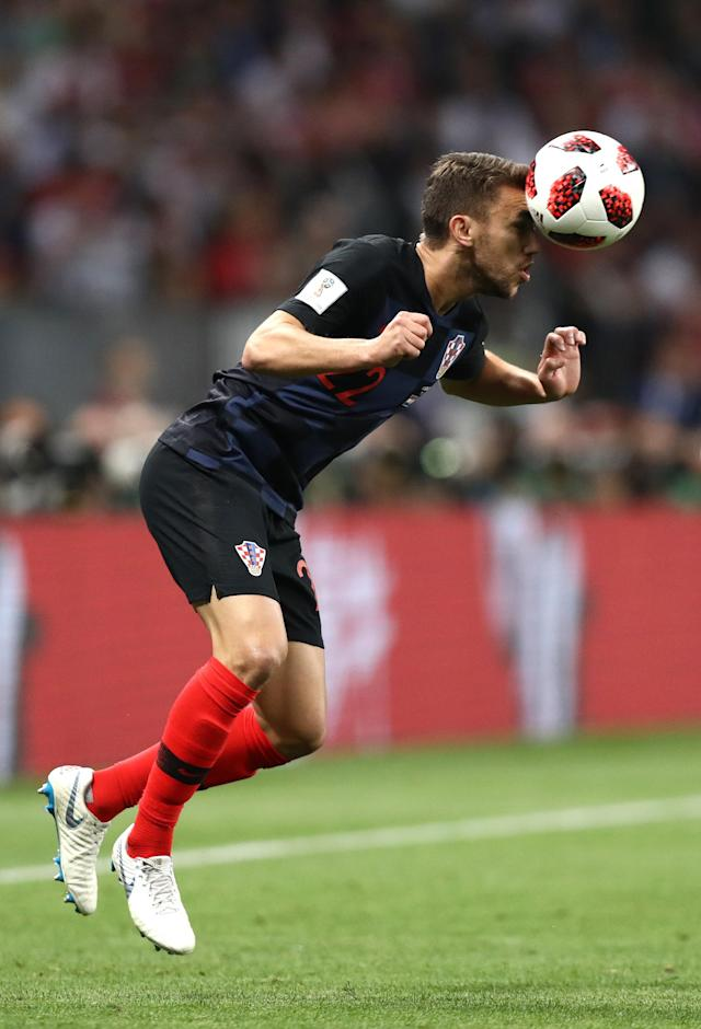 <p>Josip Pivaric of Croatia heads the ball during the 2018 FIFA World Cup Russia Semi Final match between England and Croatia at Luzhniki Stadium on July 11, 2018 in Moscow, Russia. (Photo by Ryan Pierse/Getty Images) </p>