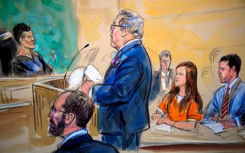 A courtroom sketch depicts Maria Butina, in orange suit listening to her attorney Robert Driscoll as he speaks to Judge Deborah Robinson during a hearing in federal court in Washington, Wednesday, July 18, 2018 - Credit: Dana Verkouteren/AP
