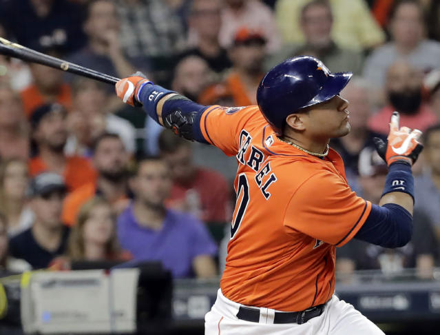 File - In this Sept. 22, 2017, file photo, Houston Astros' Yuli Gurriel hits a three-run home run against the Los Angeles Angels during the seventh inning of a baseball game in Houston. Gurriel has agreed to an $8.3 million, one-year contract with the Astros, a $300,000 raise from his originally scheduled salary for next season. (AP Photo/David J. Phillip, File)