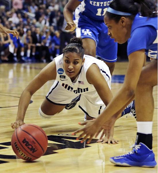 Connecticut forward Kaleena Mosqueda-Lewis, left, dives for the ball against Kentucky guard Bria Goss, right, in the first half of a women's NCAA regional final basketball game in Bridgeport, Conn., Monday, April 1, 2013. (AP Photo/Charles Krupa)