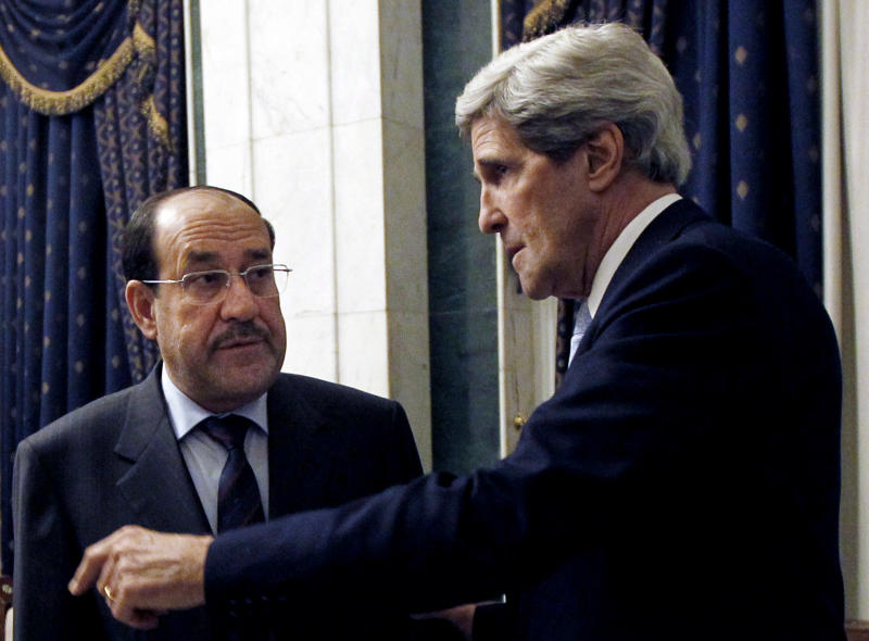 U.S. Secretary of State John Kerry, right meets with Iraq's Prime Minister Nouri al-Maliki in Baghdad, Iraq, Sunday, March 24, 2013. U.S. Secretary of State John Kerry made an unannounced visit to Iraq on Sunday and will urge Prime Minister Nouri al-Maliki to make sure Iranian flights over Iraq do not carry arms and fighters to Syria, a U.S. official said. (AP Photo/Jason Reed, Pool)