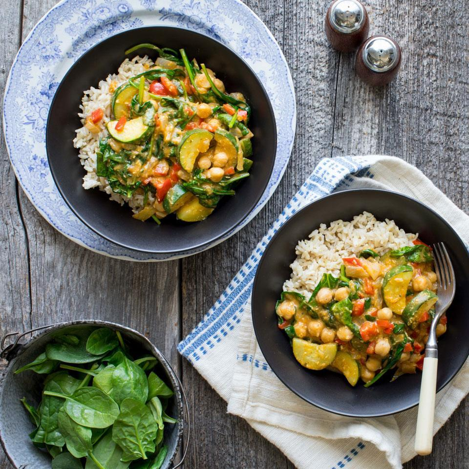 """<p>To make this 20-minute vegan curry even faster, buy precut veggies from the salad bar at the grocery store. To make it a full, satisfying dinner, serve over cooked brown rice. When shopping for simmer sauce, look for one with 400 mg of sodium or less and check the ingredient list for cream or fish sauce if you want to keep this vegan. If you like a spicy kick, add a few dashes of your favorite hot sauce at the end. <a href=""""http://www.eatingwell.com/recipe/267876/vegan-coconut-chickpea-curry/"""" rel=""""nofollow noopener"""" target=""""_blank"""" data-ylk=""""slk:View recipe"""" class=""""link rapid-noclick-resp""""> View recipe </a></p>"""