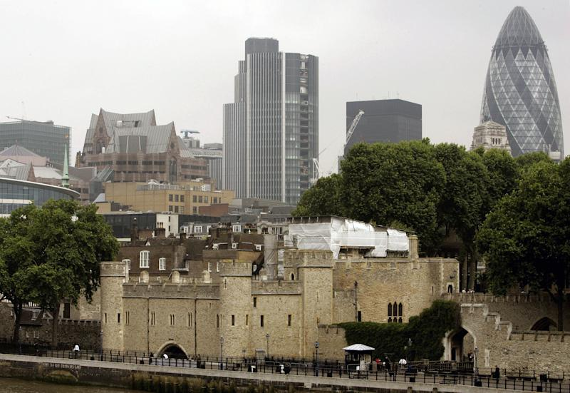 FILE This Tuesday June 12, 2007 file photo shows the Tower of London, foreground, surrounded by modern buildings in London. A rare security breach has been reported at the Tower of London, one of the British capital's most famous landmarks. Authorities say the Crown Jewels and other unique artifacts are safe but that locks had to be changed after an intruder broke in and stole some keys.  Officials said Monday Nov. 12, 2012 the keys were stolen from a sentry box at the site. (AP Photo/Kirsty Wigglesworth, File)