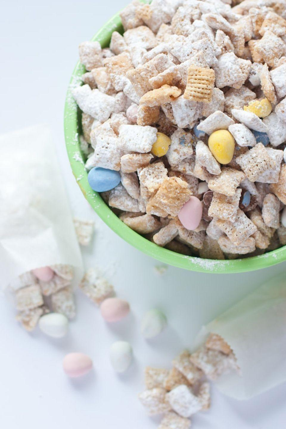 """<p>Toss some pastel-colored eggs into this <a href=""""https://www.goodhousekeeping.com/food-recipes/g3764/puppy-chow-recipes/"""" rel=""""nofollow noopener"""" target=""""_blank"""" data-ylk=""""slk:party treat"""" class=""""link rapid-noclick-resp"""">party treat</a> and watch it get devoured in minutes — we're not kidding. </p><p><em><a href=""""https://www.designeatrepeat.com/white-chocolate-puppy-chow-with-cadbury-eggs/"""" rel=""""nofollow noopener"""" target=""""_blank"""" data-ylk=""""slk:Get the recipe from Design Eat Repeat »"""" class=""""link rapid-noclick-resp"""">Get the recipe from Design Eat Repeat »</a></em> </p>"""