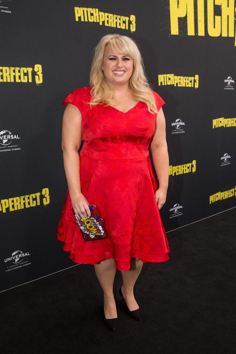 <p>Wilson still managed to keep the black carpet red hot as she wowed fans in a bright red dress. (Photo: Getty Images) </p>