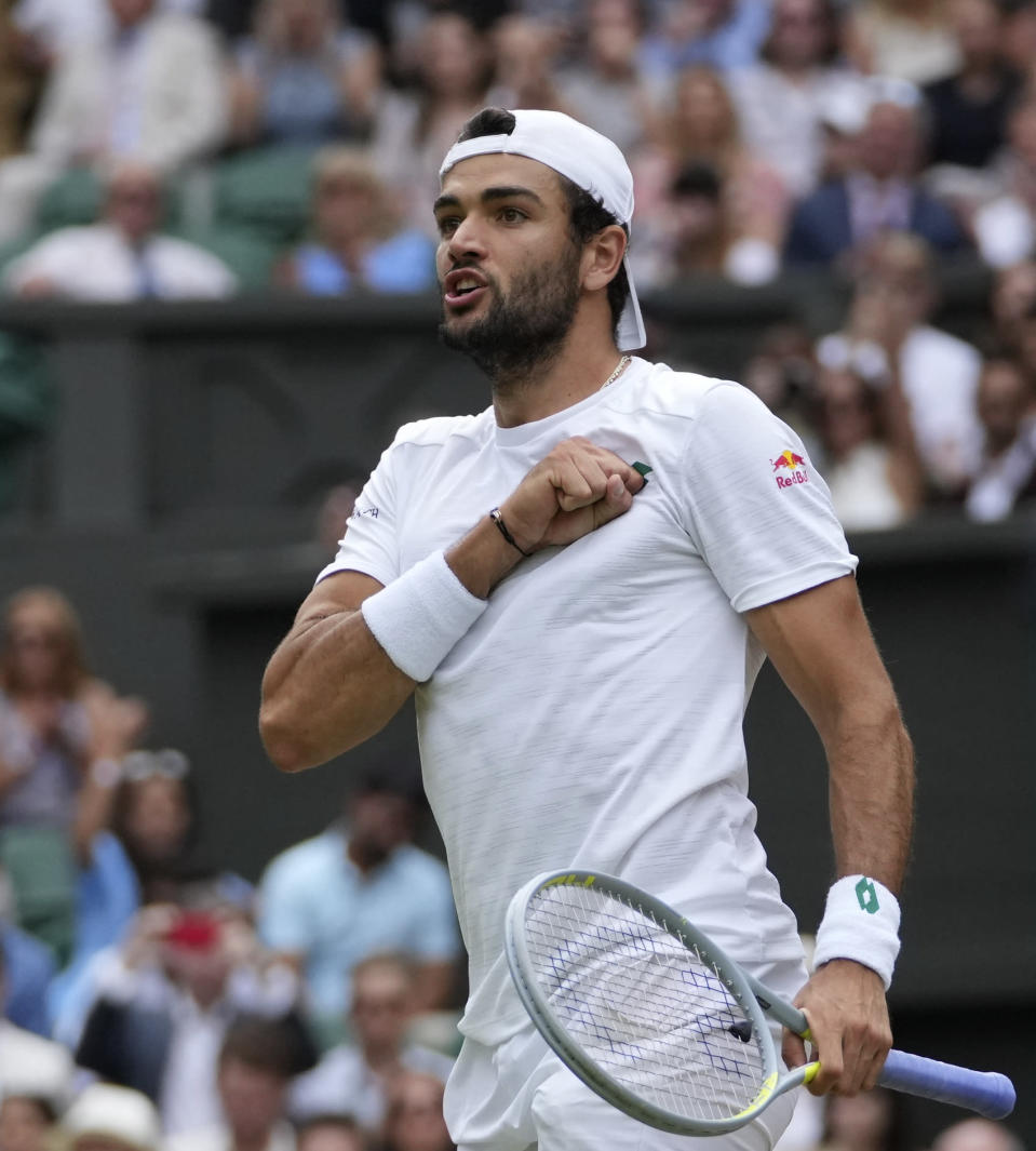 Italy's Matteo Berrettini celebrates after defeating Poland's Hubert Hurkacz during the men's singles semifinals match on day eleven of the Wimbledon Tennis Championships in London, Friday, July 9, 2021. (AP Photo/Alberto Pezzali)