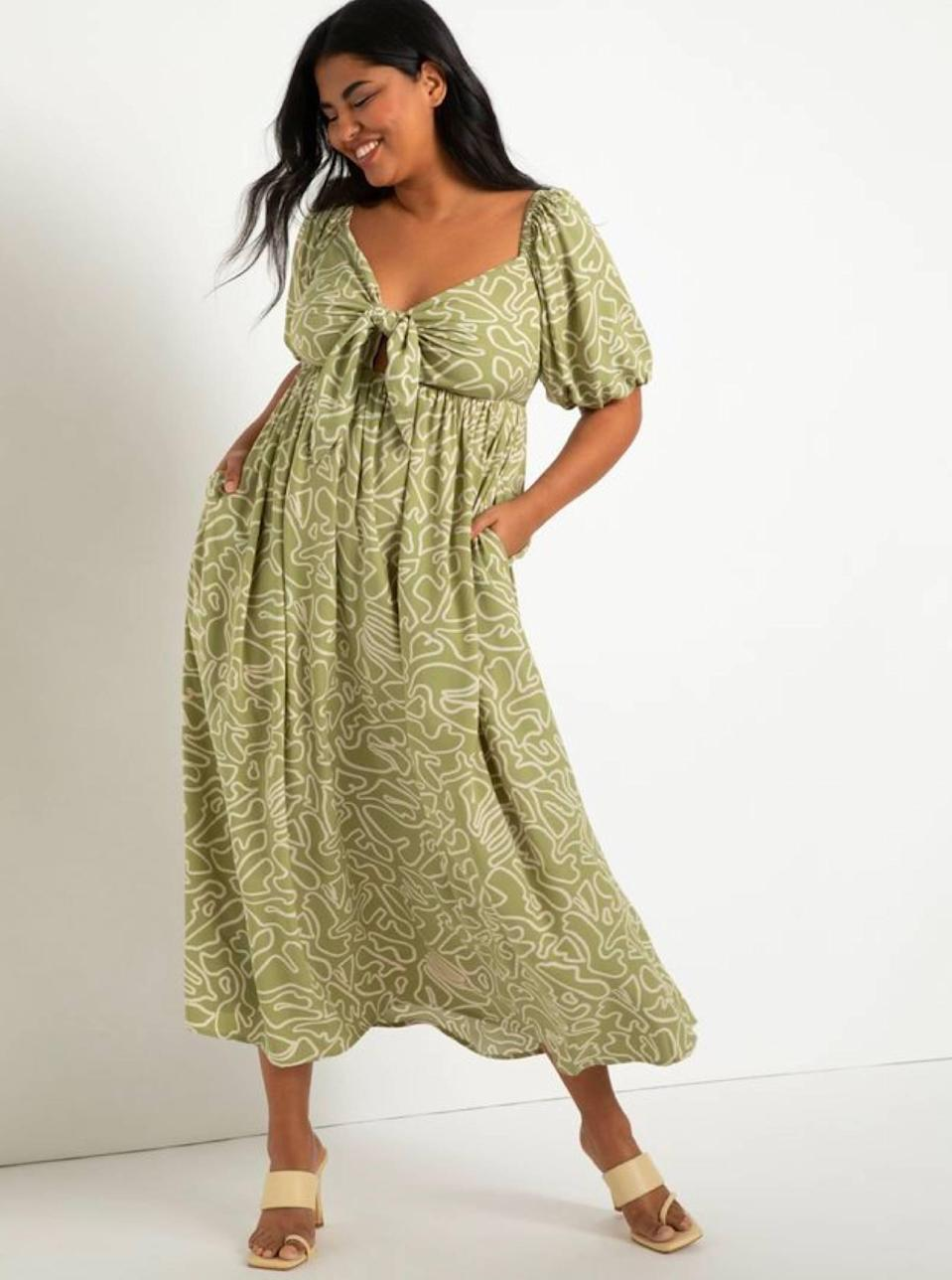 """Squiggly lines and sage green are always an instant mood boost, and this playful look deserves a spot on your summer grid. $140, Eloquii. <a href=""""https://www.eloquii.com/tie-front-full-skirted-maxi-dress/1237190.html?"""" rel=""""nofollow noopener"""" target=""""_blank"""" data-ylk=""""slk:Get it now!"""" class=""""link rapid-noclick-resp"""">Get it now!</a>"""