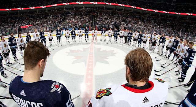 Jets and Blackhawks stood in unity to honour victims of the Humboldt Broncos. (Getty)