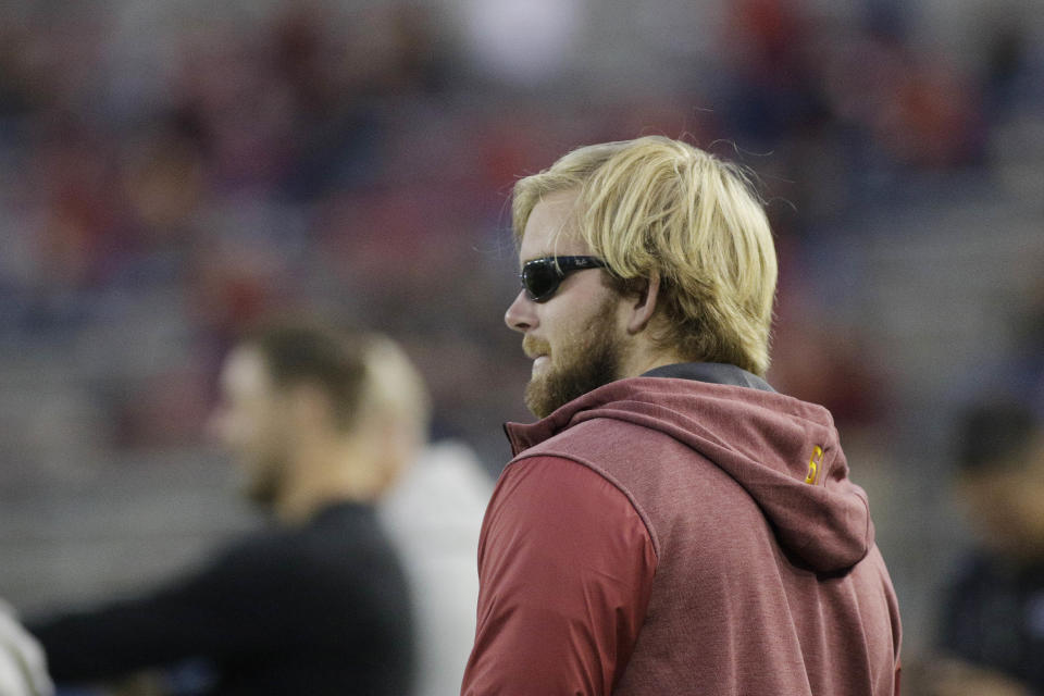 Southern California long snapper Jake Olson, who is blind form a rare form of retinal cancer, stands on the sidelines before an NCAA college football game between Washington State and Southern California in Pullman, Wash., Friday, Sept. 29, 2017. (AP Photo/Young Kwak)